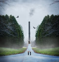 Young woman walking down road toward smokestack Stock Photo