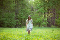 Young woman walking on a forest glade Royalty Free Stock Photo