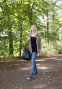 Young woman walking in the park Royalty Free Stock Photos