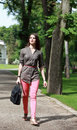 Young woman walking in a park beautiful with latop bag summer Royalty Free Stock Images