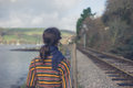 Young woman walking by railway tracks Royalty Free Stock Photo