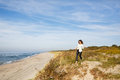 Young woman walking on the seacoast Royalty Free Stock Photo