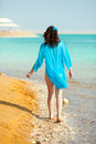 Young woman walking seashore on dead sea Stock Photos