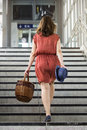 Young woman walking stairs at a train station Royalty Free Stock Photo