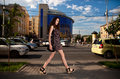 Young woman walking at the street in city Stock Photo