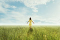 Young woman walking on summer meadow Royalty Free Stock Photo