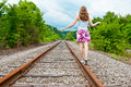 A young woman walking on train tracks Royalty Free Stock Photos