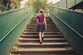 Young woman walking up stairs Royalty Free Stock Photo