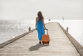 Young woman walking on wooden pier Stock Images