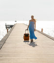 Young woman walking on wooden pier Royalty Free Stock Images