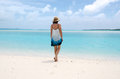 Young woman walks barfoot on deserted tropical island barefoot in aitutaki lagoon cook islands Royalty Free Stock Photos