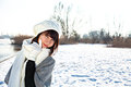 Young woman in warm clothes outdoor in a winter day portrait of beautiful outdoors Royalty Free Stock Images