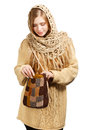 Young woman in warm clothing with knitted bag beautiful winter standing isolated on white background Stock Photography