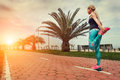 Young woman warm up legs before start jogging Royalty Free Stock Photo