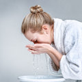 Young woman washing face Royalty Free Stock Photo
