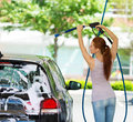 Young woman washing her car Royalty Free Stock Photo