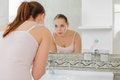 Young woman washing her face with clean water in bathroom Royalty Free Stock Photo
