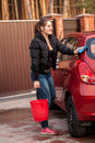 Young woman washing her small red car beautiful Royalty Free Stock Photos