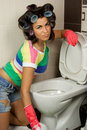 Young woman washing toilet in the flat Stock Photo