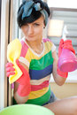 Young woman washing windows in the flat Royalty Free Stock Image