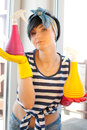 Young woman washing windows in the flat Stock Photography