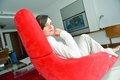 Young woman watching tv at home happy modern livingroom Royalty Free Stock Image