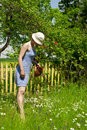 Young woman watering flowers in the garden Royalty Free Stock Photo