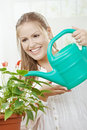 Young woman watering plant Stock Photos