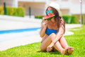 Young woman with watermelon relaxing outdoor near pool at summer vacation Royalty Free Stock Photo