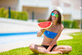 Young woman with watermelon relaxing outdoor at summer vacation Royalty Free Stock Photo