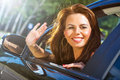 Young woman waving hand Royalty Free Stock Image