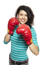 Young woman wearing boxing gloves smiling white background Royalty Free Stock Image