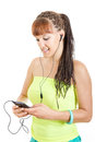 Young woman wearing earphones listening to music over smart phon phone smiling girl browsing her phone using mp player Stock Images