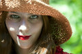 Young woman wearing hat and beautiful red lipstick looking at camera Royalty Free Stock Photos