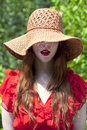 Young woman wearing hat and beautiful red lipstick looking at camera Royalty Free Stock Image