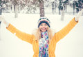 Young woman wearing hat and scarf happy smiling hands raised outdoor enjoy winter snow travel lifestyle Stock Photos
