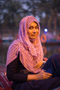 Young woman wearing hijab head scarf in city smile happy face portrait, traditional muslim clothes, latest fashion