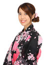 Young woman wearing japanese kimono over white background Stock Photos