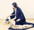 Young woman wearing kimono pouring tea beautiful japanese from cast iron pot Stock Photos