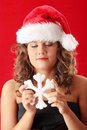 Young woman wearing santa claus hat Stock Images