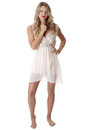 Young woman wearing sheer flimsy dress confused Royalty Free Stock Image
