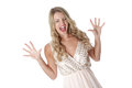 Young woman wearing sheer flimsy dress frightened scared Stock Photography