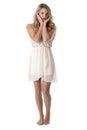 Young woman wearing sheer flimsy dress sad Stock Image