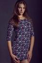 Young woman wearing short flower dress. Model fashion shooting Royalty Free Stock Photo