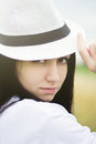 Young woman wearing summer straw hat Royalty Free Stock Photography
