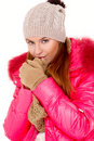 Young woman wearing winter jacket scarf and cap Royalty Free Stock Images