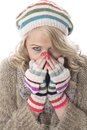 Young woman wearing a wooly hat and gloves cold Stock Photography