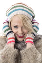 Young woman wearing a wooly hat and gloves cold Stock Image