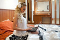 Young woman with wedding dress and laptop. Stock Photo