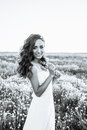 Young woman in wedding dress outdoors. beautiful bride in a field at sunset. Black and white Royalty Free Stock Photo